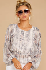7 Something So Great Blush Multi Snake Print Top at reddressboutique.com