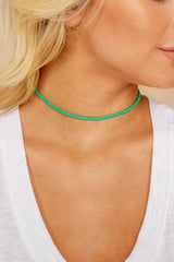 1 Looking For This Light Green Necklace at reddressboutique.com