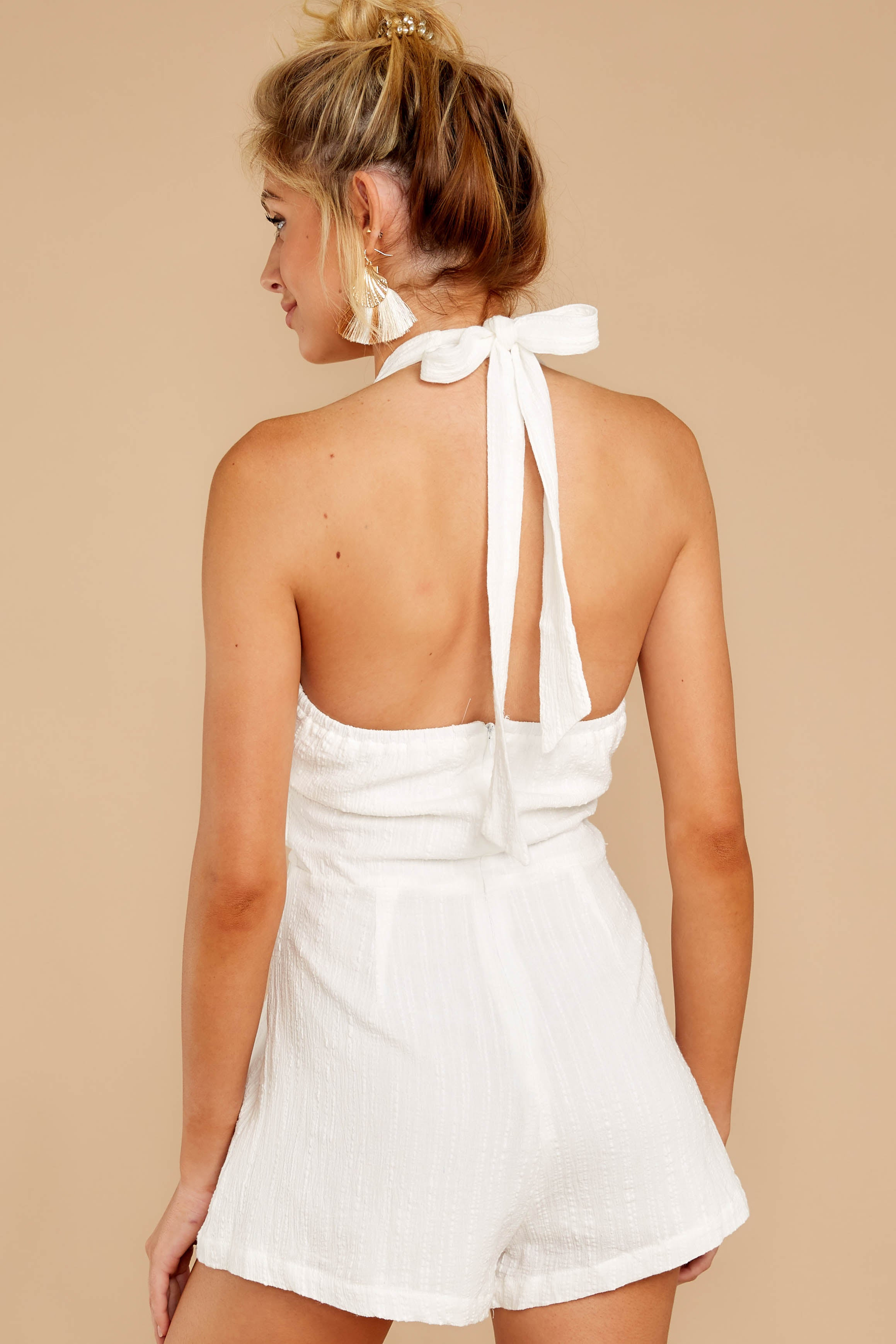 7 Inspire Optimism White Romper at reddressboutique.com