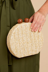 1 Add This Little Beige Clutch at reddressboutique.com
