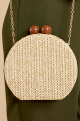3 Add This Little Beige Clutch at reddressboutique.com
