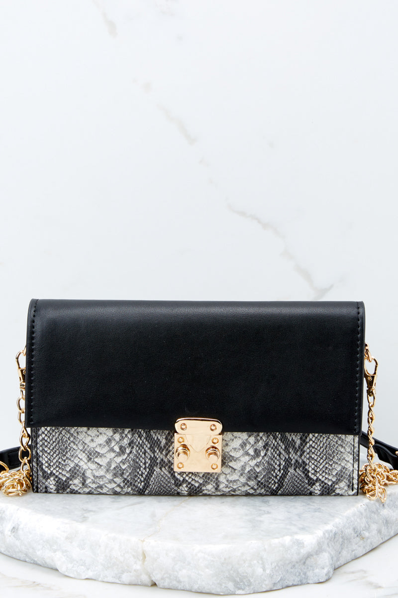 3 Waiting On Promises Black And Snake Skin Clutch at reddressboutique.com