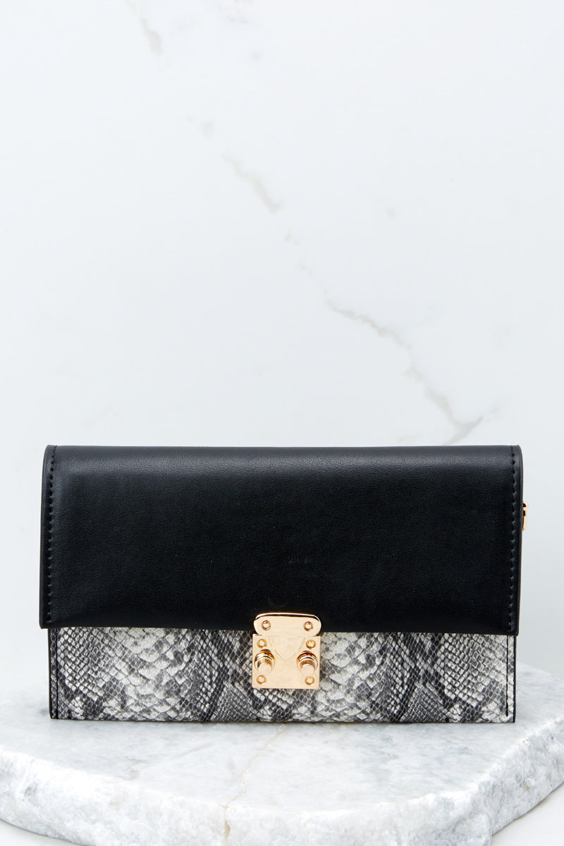 4 Waiting On Promises Black And Snake Skin Clutch at reddressboutique.com