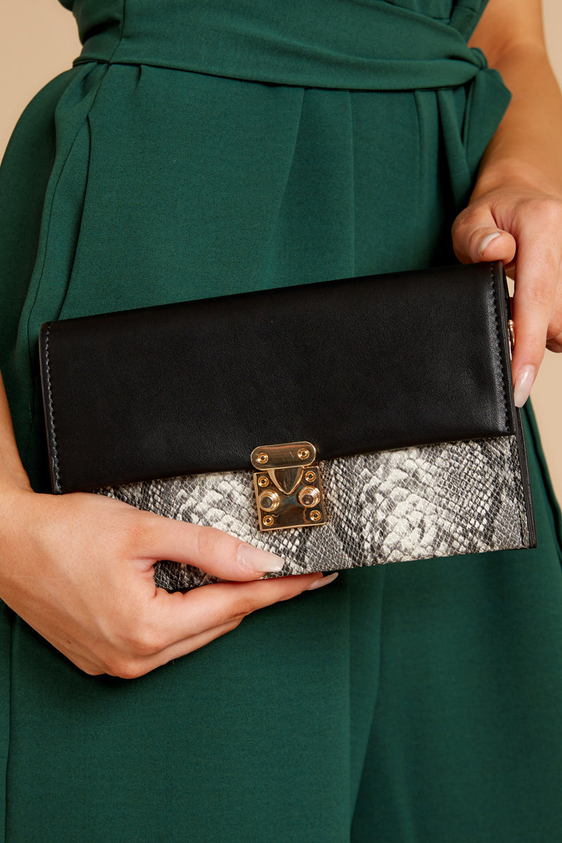 6 Waiting On Promises Black And Snake Skin Clutch at reddress.com