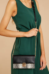 2 Waiting On Promises Black And Snake Skin Clutch at reddressboutique.com