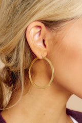 1 Turn This Around Gold Hoop Earrings at reddressboutique.com