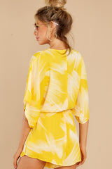 7 Sungazer Yellow Print Romper at reddress.com