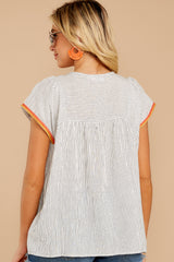 7 Fabulous Flashback Grey Stripe Embroidered Top at reddressboutique.com