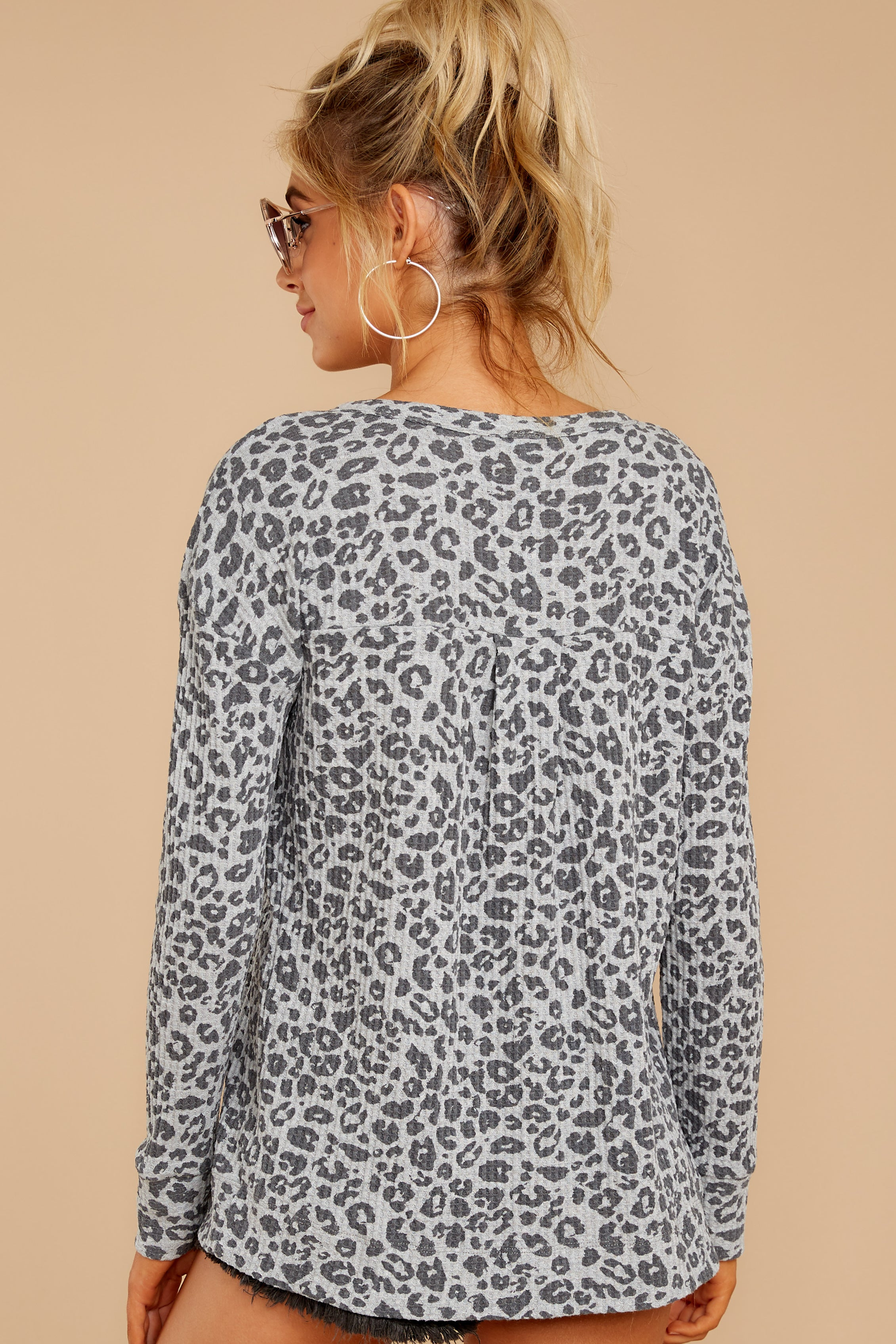 7 The Grey Leopard Waffle Split Neck Thermal at reddressboutique.com