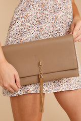 6 Stealing Hearts Brown Tasseled Clutch at reddressboutique.com