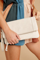 1 Marlena Ivory Snakeskin Clutch at reddressboutique.com