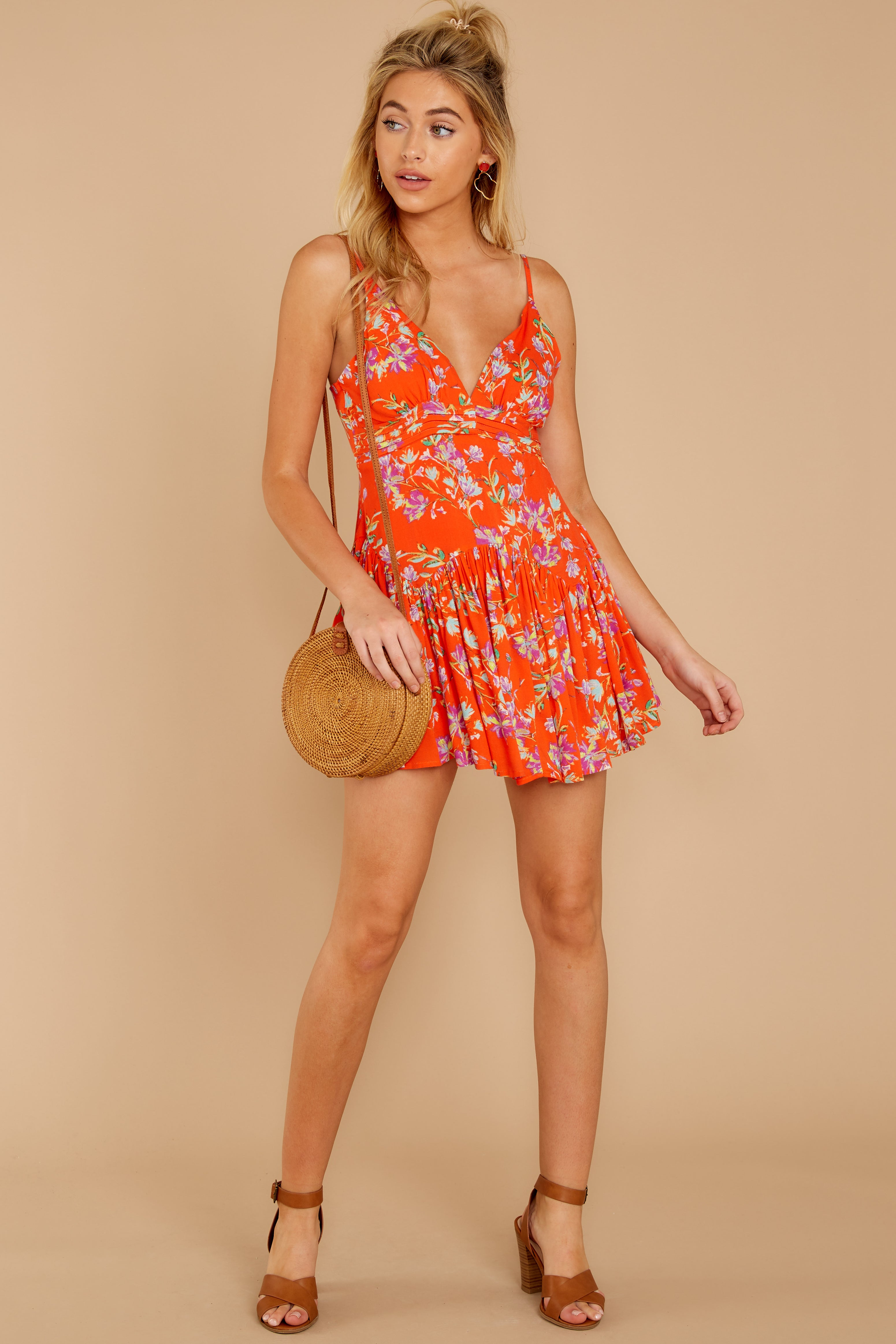 2 In The Sunshine Bright Orange Floral Print Romper at reddressboutique.com