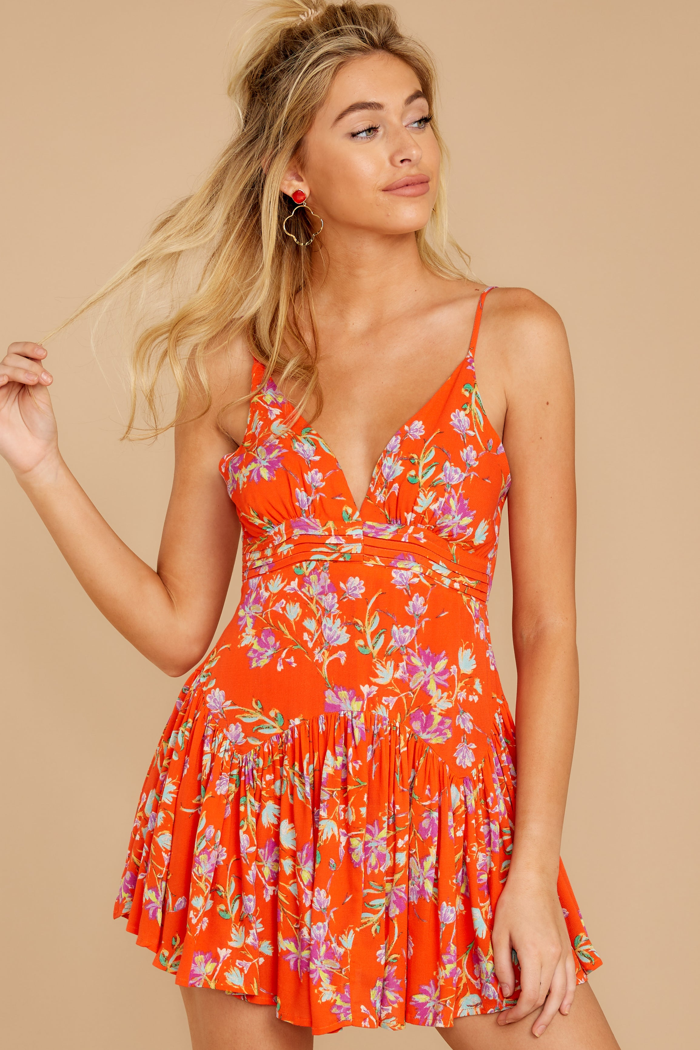 9 In The Sunshine Bright Orange Floral Print Romper at reddressboutique.com
