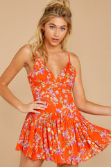 11 In The Sunshine Bright Orange Floral Print Romper at reddressboutique.com