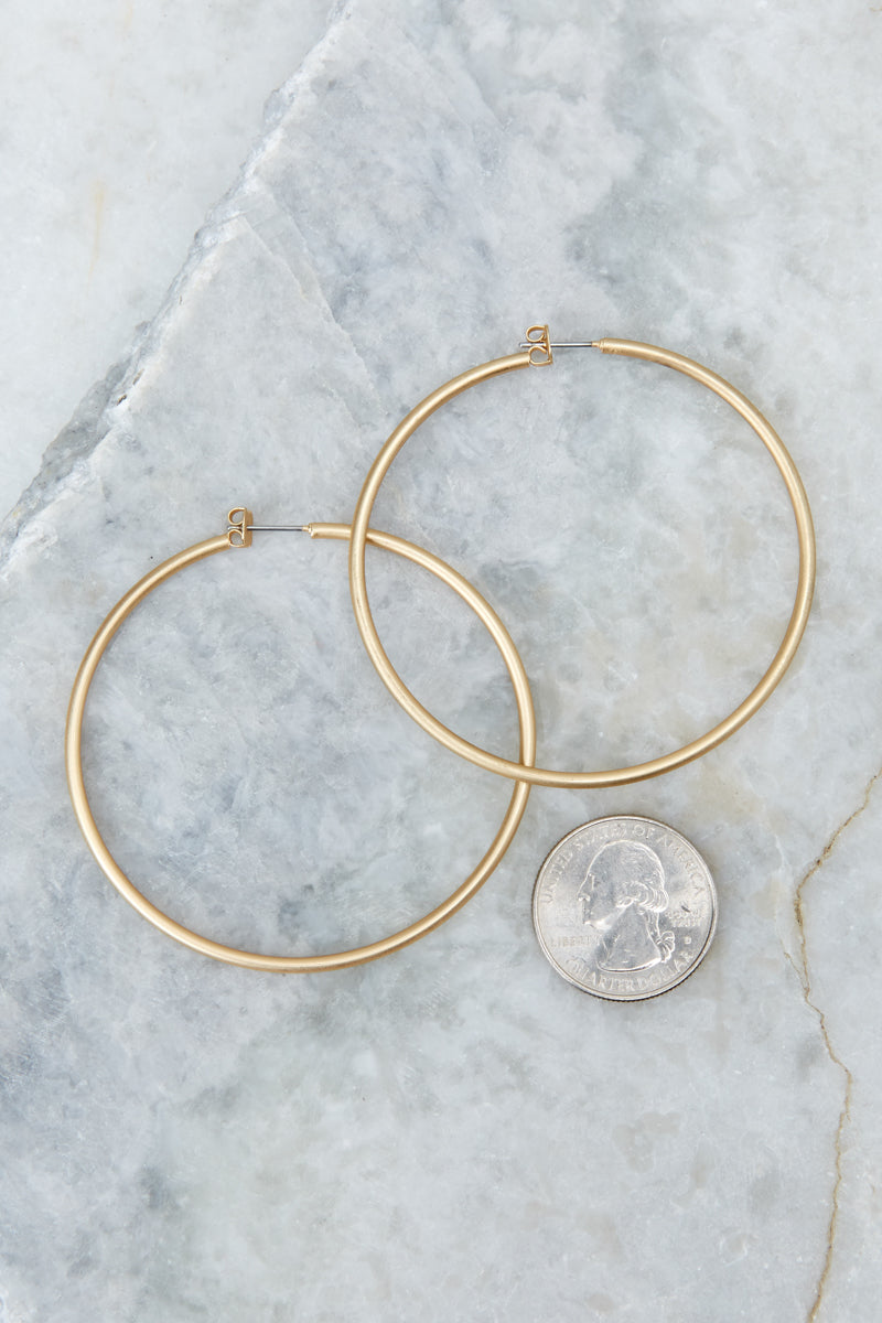 4 Circle Up Gold Hoop Earrings at reddressboutique.com