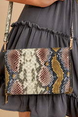 1 Read Into This Snake Print Purse at reddressboutique.com