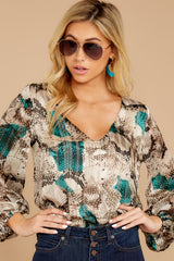 6  For The Bold Teal Multi Snake Print Bodysuit at reddressboutique.com