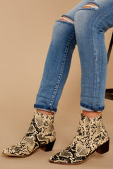 1  The Good Ones Snakeskin Studded Ankle Boots at reddressboutique.com