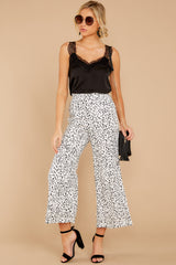 6 On The Lookout White Cheetah Print Pants at reddressboutique.com