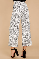 4 On The Lookout White Cheetah Print Pants at reddressboutique.com