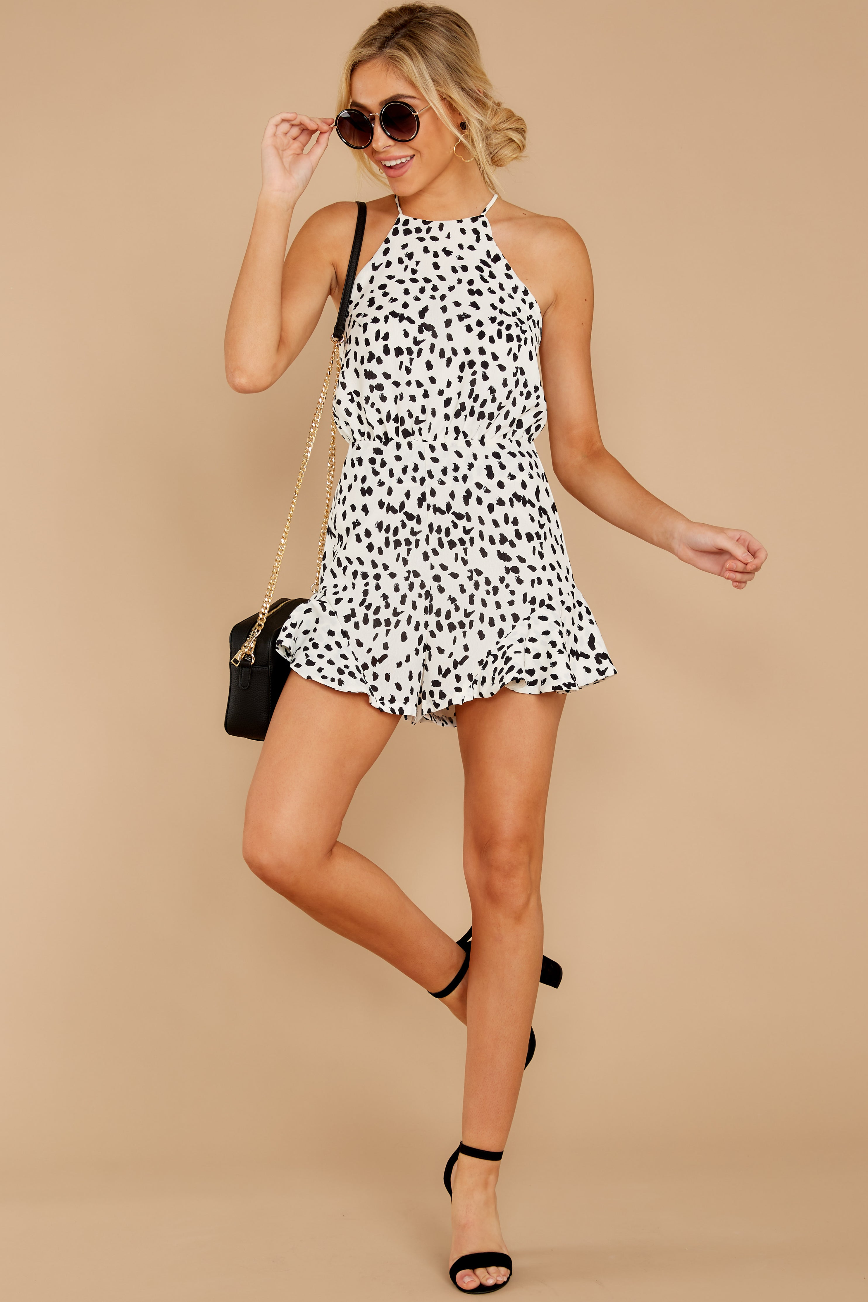 5 She Stops Traffic White Cheetah Print Romper at reddress.com