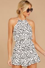 8 She Stops Traffic White Cheetah Print Romper at reddress.com