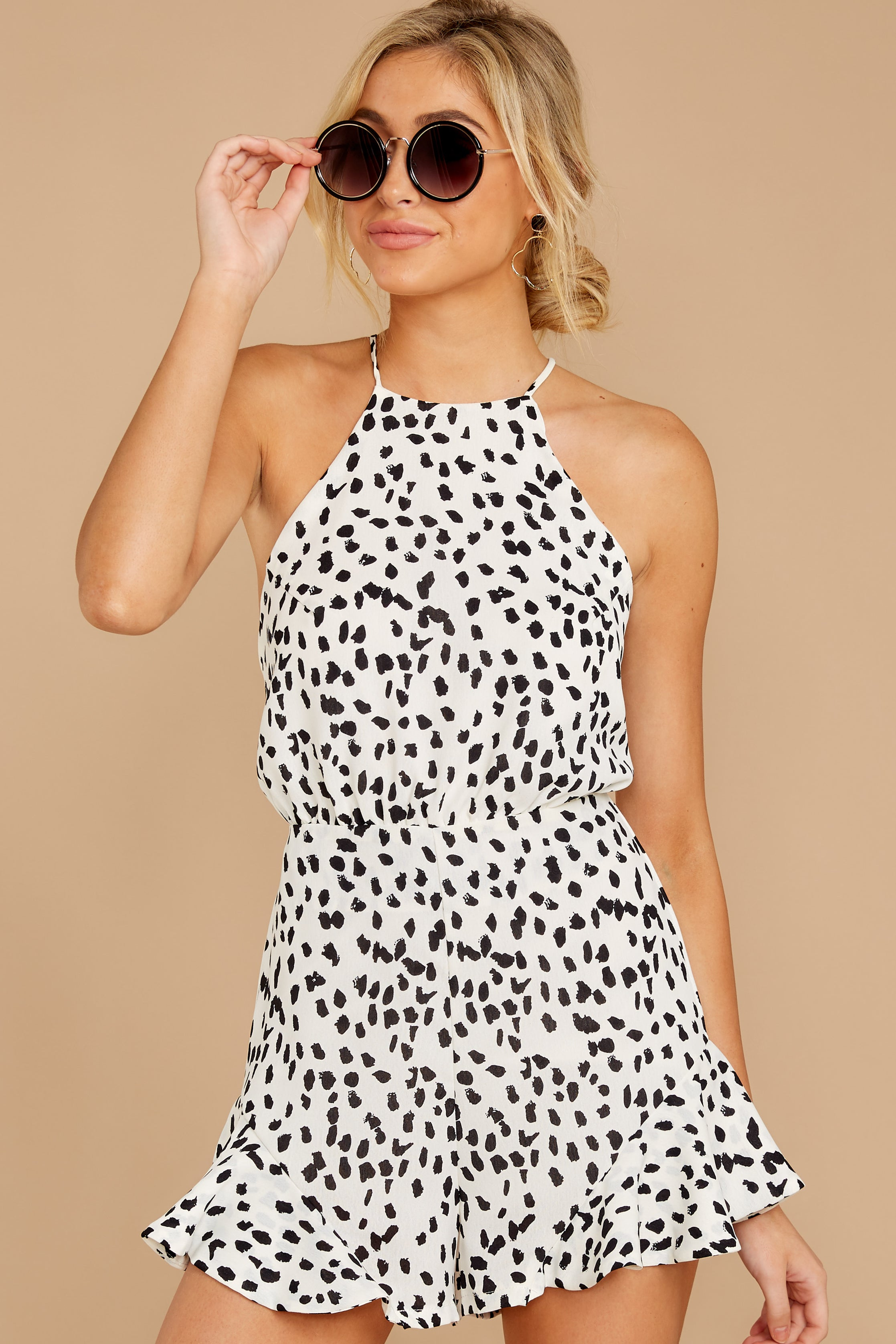 9 She Stops Traffic White Cheetah Print Romper at reddress.com