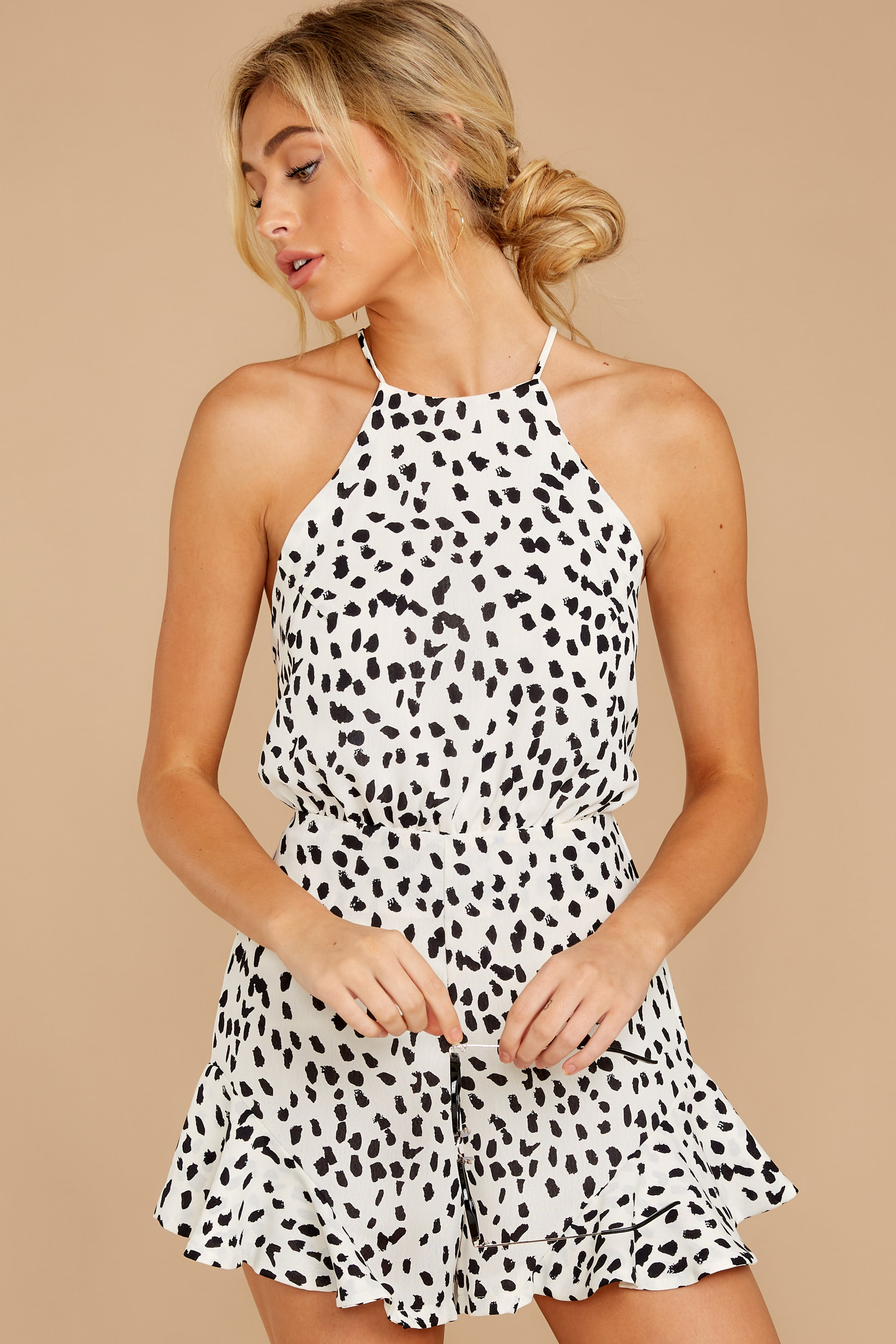 10 She Stops Traffic White Cheetah Print Romper at reddress.com