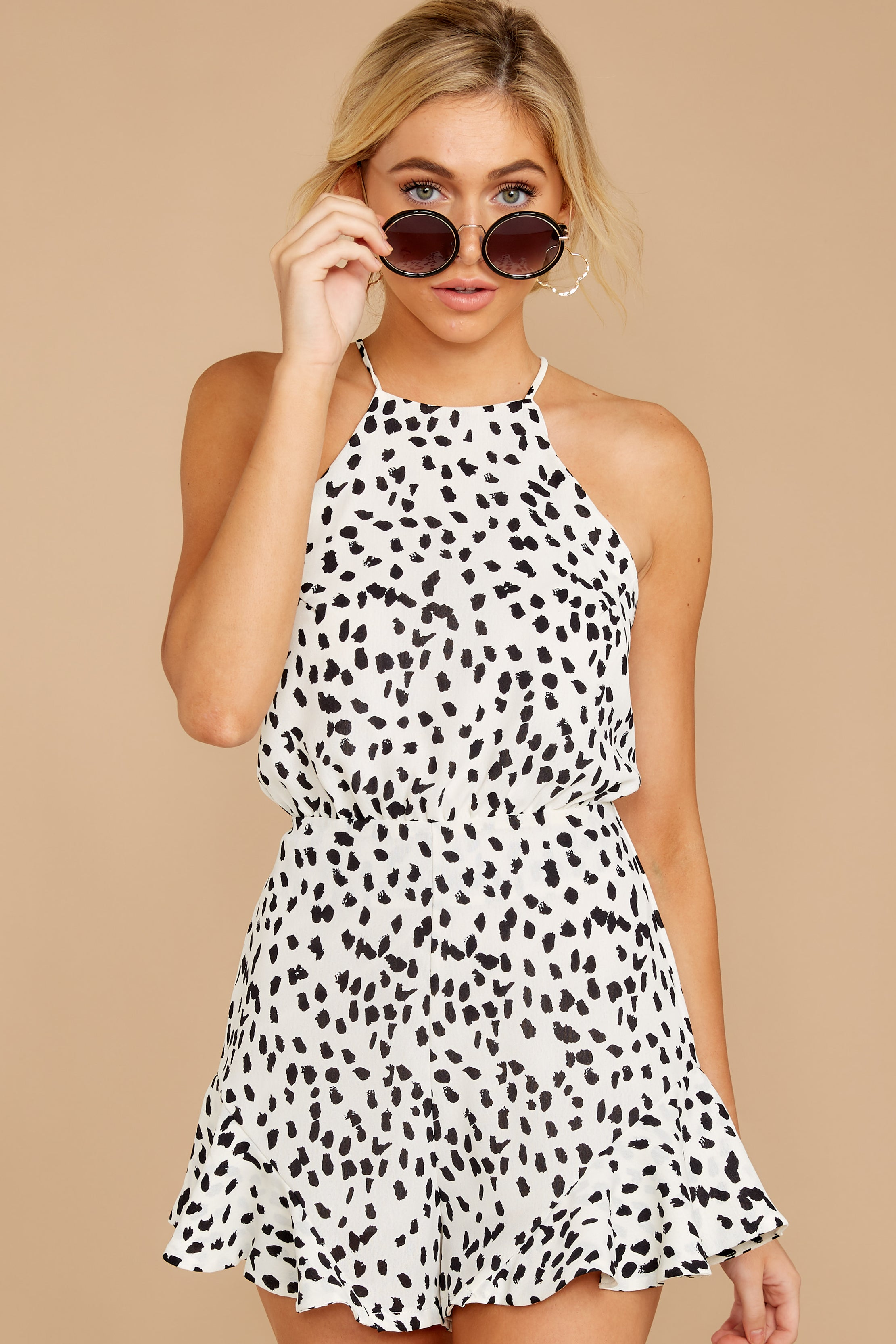 11 She Stops Traffic White Cheetah Print Romper at reddress.com