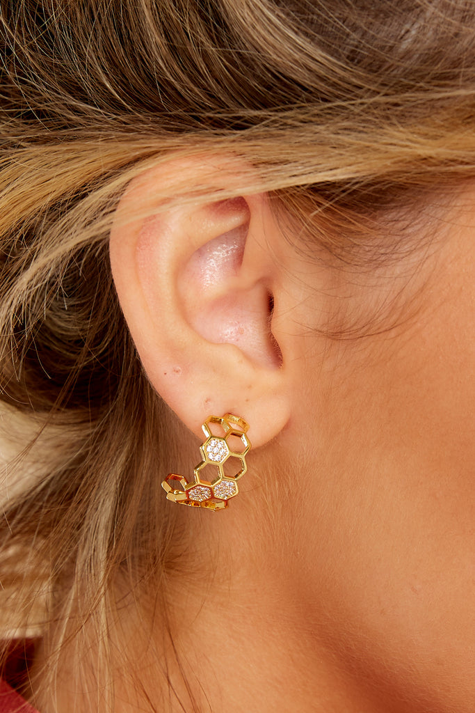 4 Faithful Gold Huggie Earrings at reddressboutique.com