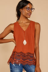 7 Listening To The Muses Rust Orange Top at reddressboutique.com