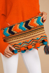 7 Pom It Out Orange Multi Embroidered Clutch at reddressboutique.com