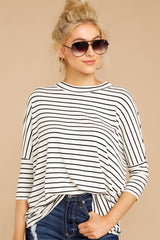 1 See This Smile White And Black Stripe Top at reddressboutique.com