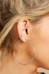 4 Beyond Reason Silver Hoop Earrings at reddressboutique.com