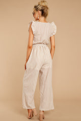 7 Keep Your Chin Up Taupe Stripe Jumpsuit at reddressboutique.com