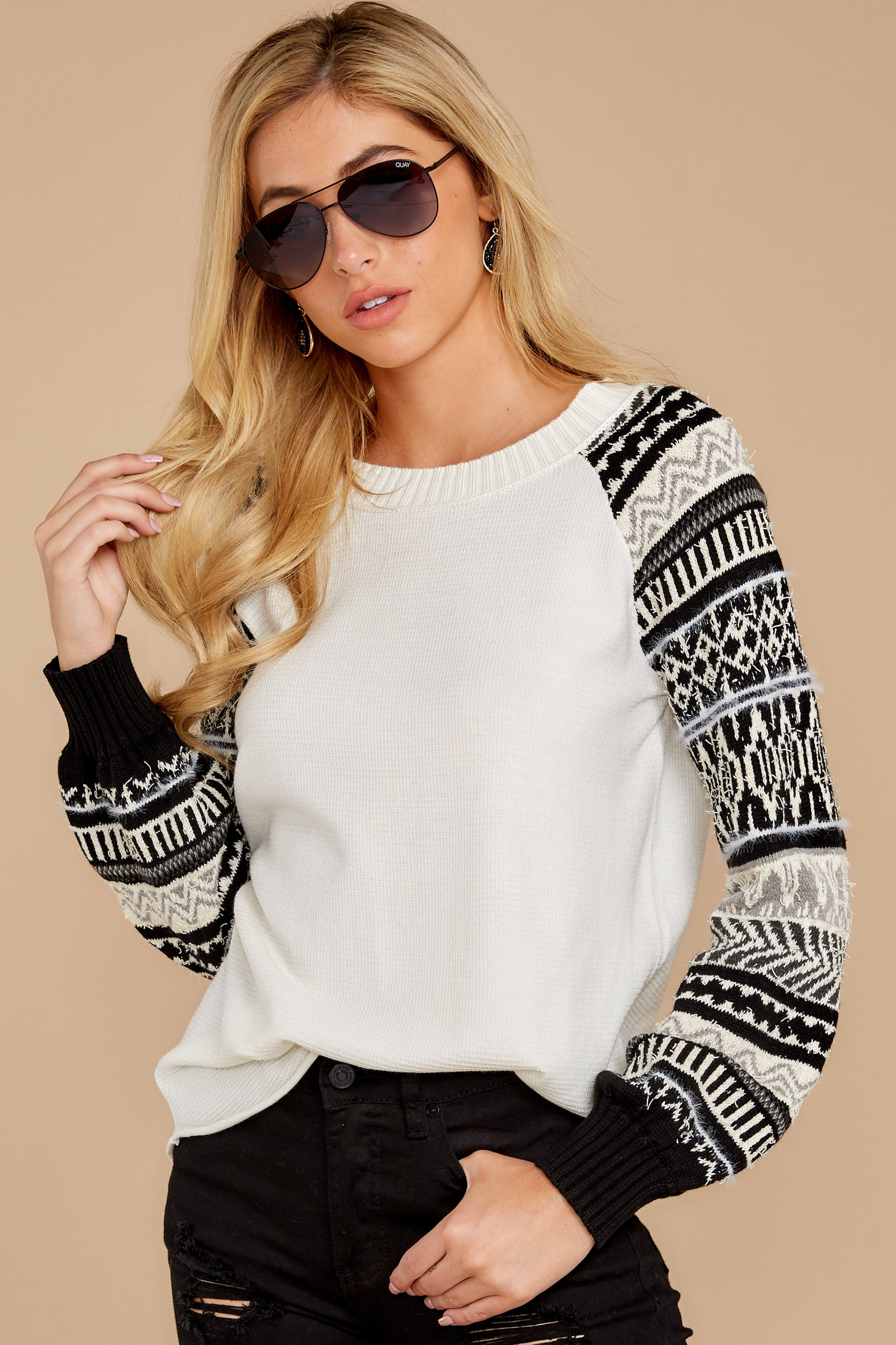 7 Never Settle Black And White Sweater at reddressboutique.com
