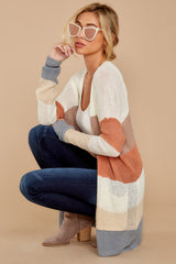 7 Tell Me About It Ivory Multi Stripe Cardigan at reddressboutique.com