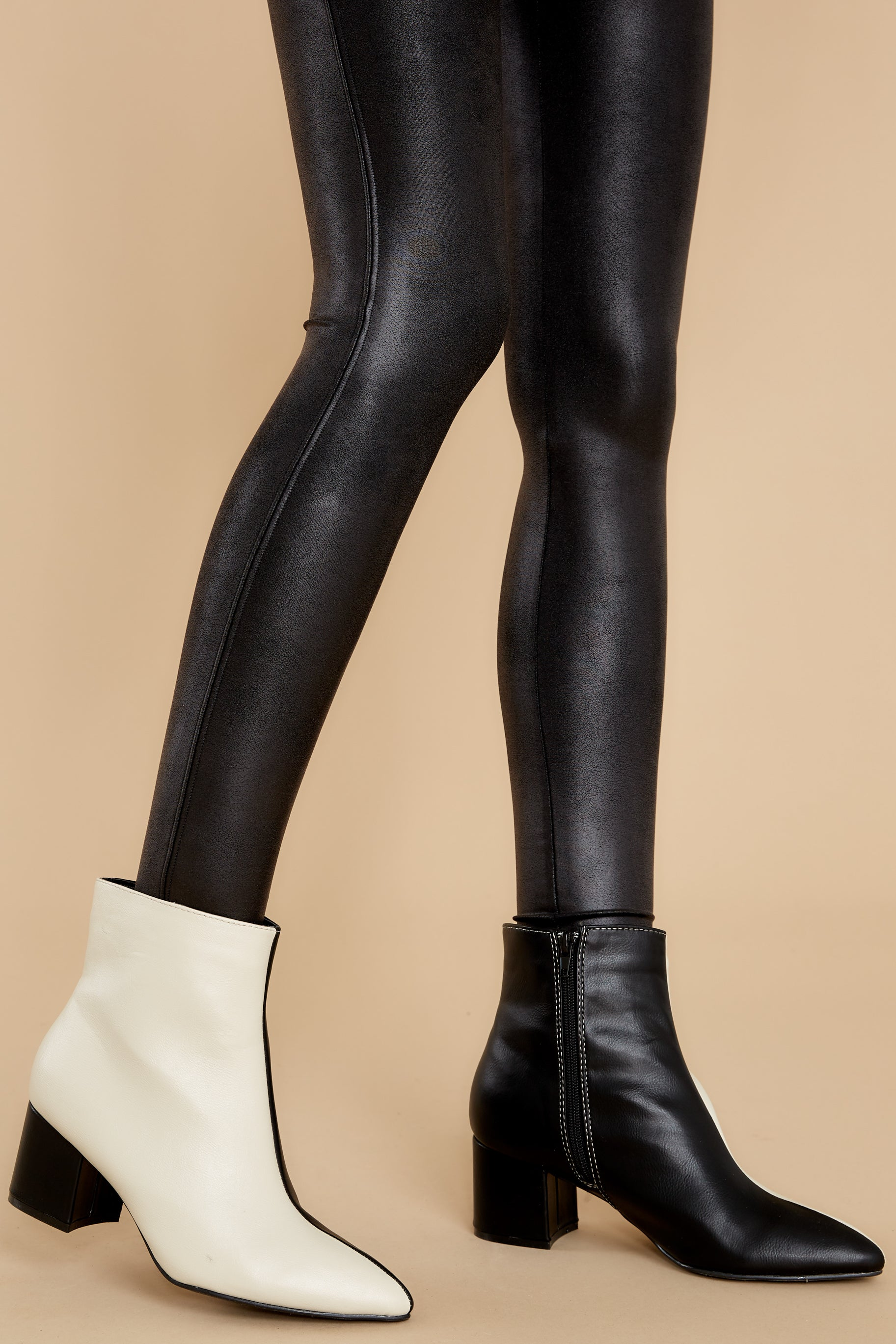 1 Split Decision Ivory And Black Ankle Booties at reddress.com
