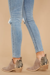 1 Sonni Taupe Snakeskin Booties at reddressboutique.com
