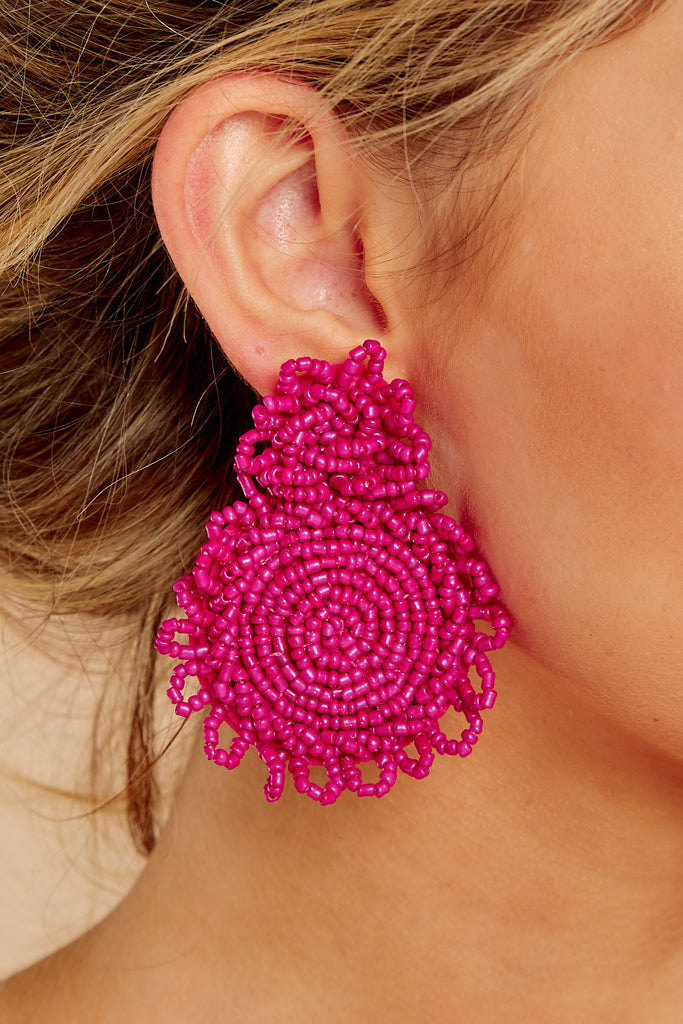 1 She's Famous Fuchsia Pink Tasseled Earrings at reddressboutique.com