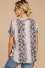 8 She's On The Move Snake Print Tie Top at reddressboutique.com