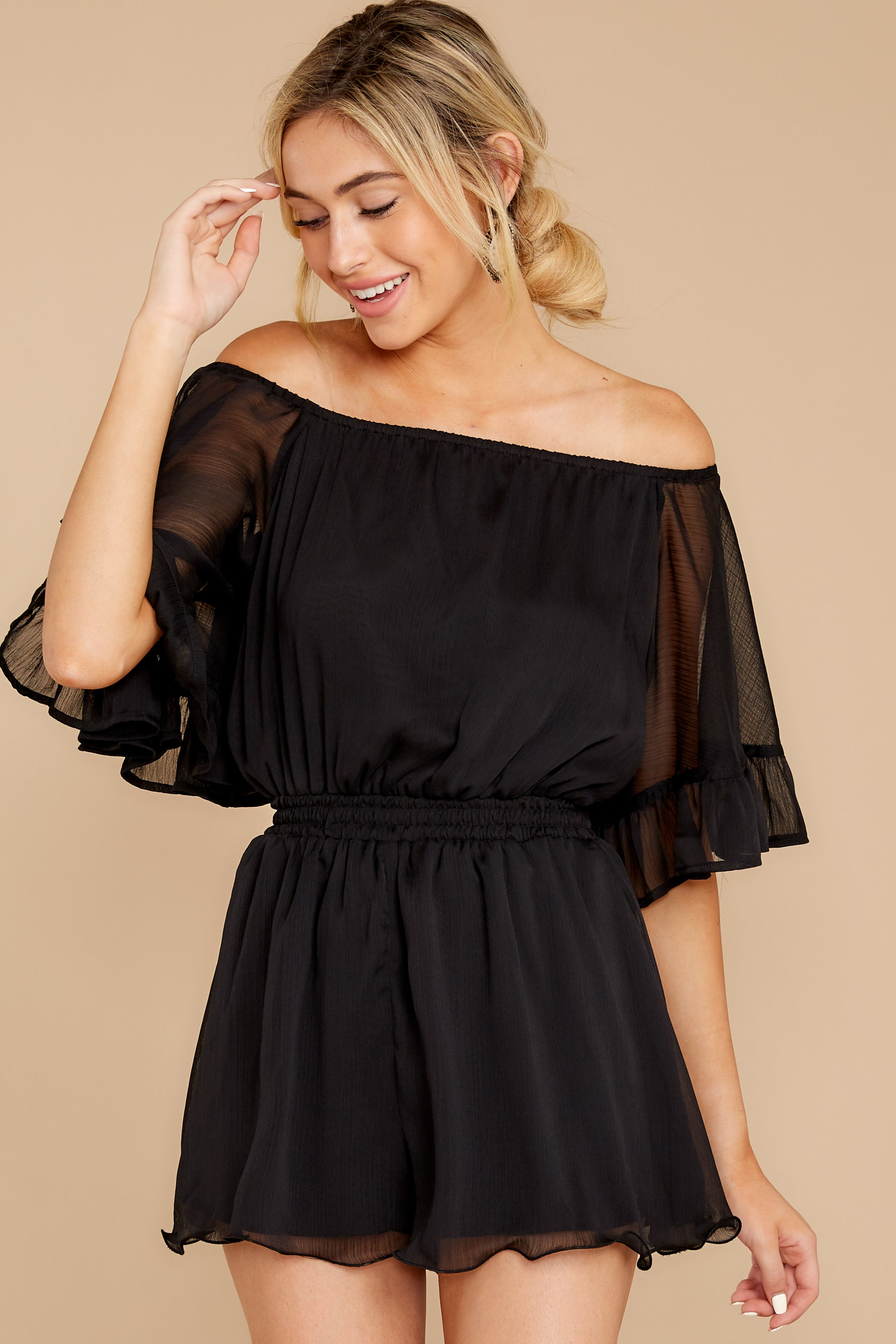 7 A Little Diddy Black Romper at reddressboutique.com