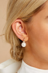 1 Take A Glisten Gold Pearl Earrings at reddressboutique.com