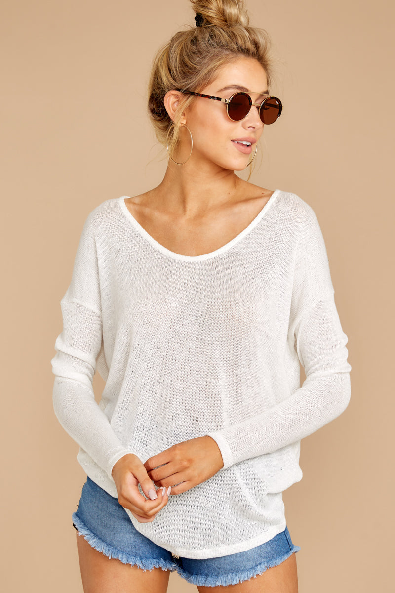 7 A Night In Ivory Knit Top at reddressboutique.com