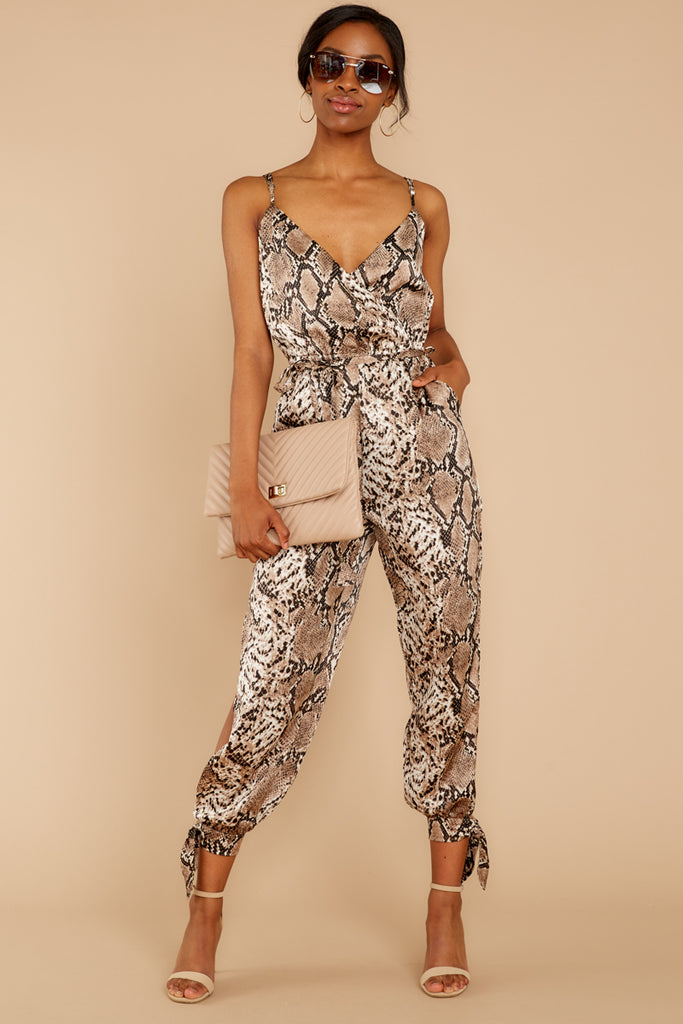 5 Thinking About Running Ivory Snake Print Jumpsuit at reddressboutique.com
