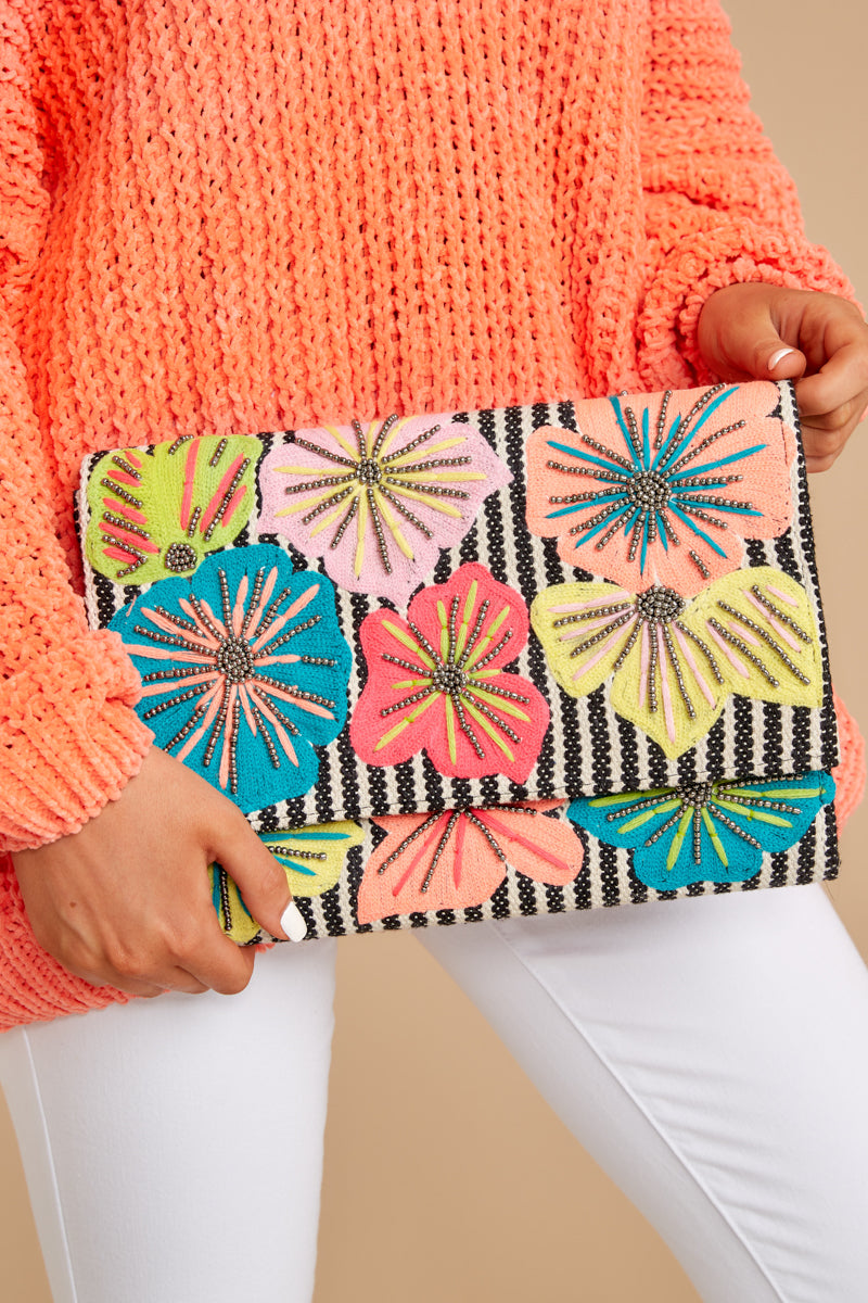 2 Growing Beads Floral Clutch at reddressboutique.com