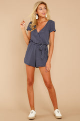 3 The Black Iris Micro Stripe Surplice Romper at reddressboutique.com