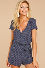 5 The Black Iris Micro Stripe Surplice Romper at reddressboutique.com