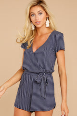 6 The Black Iris Micro Stripe Surplice Romper at reddressboutique.com
