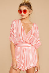 5 Get It Together Coral Pink Stripe Romper at reddressboutique.com